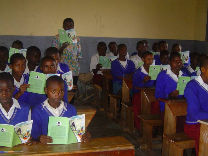 "Pupils studying the book ""A day in gorillaland"""